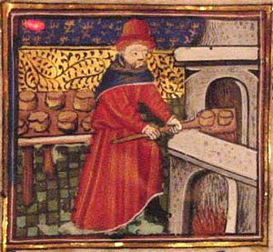 Man baking bread in medieval Europe