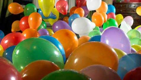 a room full of colorful helium balloons