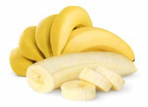 bananas, one of them peeled and sliced