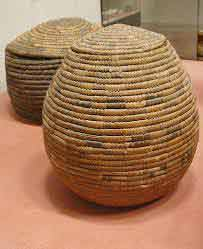 Two plain baskets in oval shapes with lids