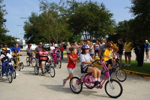 Kids with challenges ride special bikes(Wheels to Succeed)