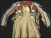 A Blackfoot shirt made of rawhide with trade beads embroidered on it