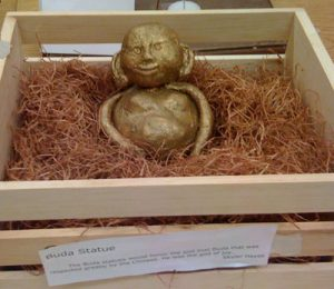 Gold Buddha statue in a box