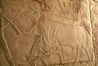 Egyptian carving of men and a bull