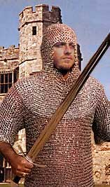 A white man wearing a chain mail shirt and carrying a sword