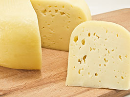 Cow's milk cheese: yellow, with holes in it