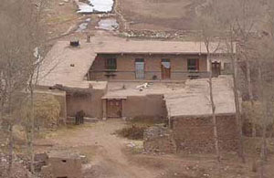 A house in China built of mud-brick with a tile roof