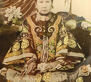 photo of a Chinese woman sitting down in very fancy robes