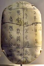 Oracle bone with Chinese characters written on it
