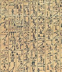Egyptian hieroglyphics - lots of tiny pictures on a brown page