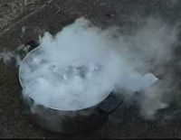 a cup with a cloud of steam coming off it