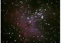 Eagle Nebula: photograph of a cluster of stars in space