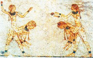 Egyptian girls playing a piggyback ball toss game