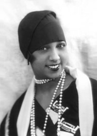 An African-American woman wearing strings of pearls