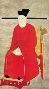Emperor Gaozong in a long red robe sitting in a chair