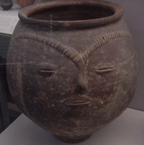 A Gaulish clay pot with a face on it