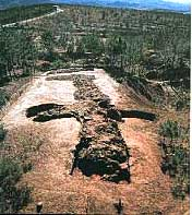 ruins of a temple on a dirt mound