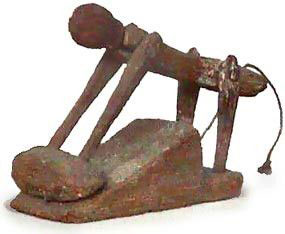 Ancient Egyptian wooden pull toy of a woman grinding grain