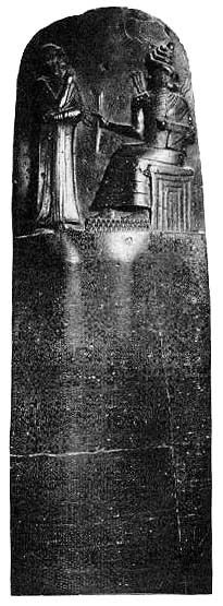 Code of Hammurabi - a tall black pillar with writing on it and a man standing before a god carved at the top