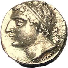 profile of a white man with a large nose, curly hair, and a headband, on a gold coin