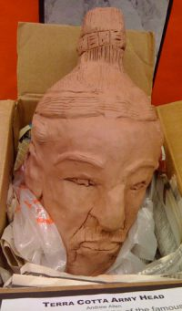 a red clay head of a man
