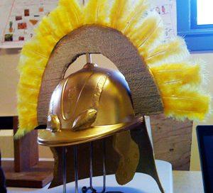 A Roman helmet made from a baseball cap spray painted gold