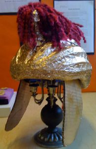 A Roman helmet model made out of a bike helmet covered with tinfoil