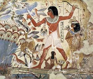 Egyptian wall painting of a brown-skinned man hunting a flock of birds in long grass by the river