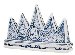 blue and white porcelain brush rest in the shape of five mountains with Arabic writing on it