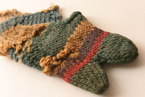 Late Roman sock knitted in colorful stripes with a separate big toe