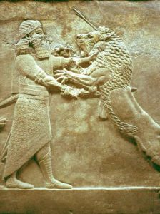 Assyrian stone carving of a man wrestling a lion