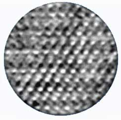 magnified atoms - looks like an uneven black and white and gray waffled surface