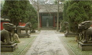 A Chinese walkway, garden, and tomb