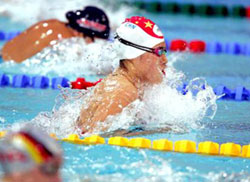 a woman swimming in a pool competitiion