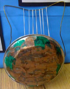 Piepan and strings and a coat hanger make a Greek lyre