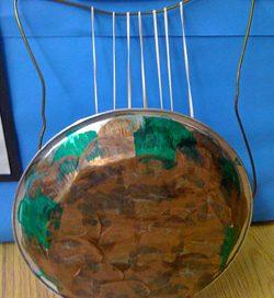 Piepan and strings make a Greek lyre