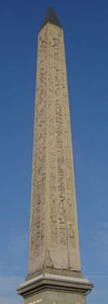 Obelisk from Luxor: a tall pointed stone with hieroglyphs on it