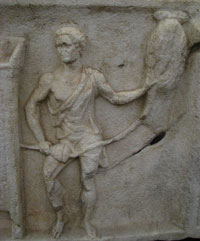 Roman stone carving of a man spinning flax, barefoot and wearing only a short tunic