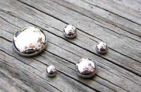 balls of mercury: silver globes on a wooden deck