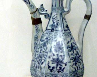 blue and white pottery pitcher, very tall and elegant