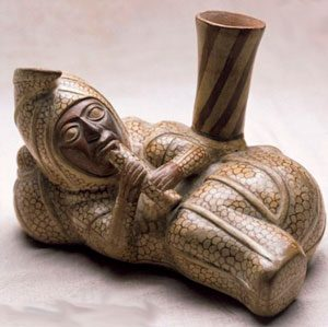 Moche image of a peanut-man playing an instrument