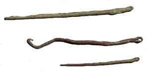 Three bronze sewing needles