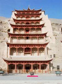 seven stories of balconies painted red carved into the side of a cliff