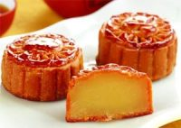 Chinese moon cakes - small round yellow caks with brown sugar on the outside