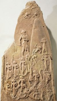 Stele of Naram-Sin: a triangular stone with an army carved on it marching uphill