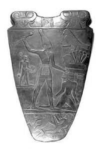 Narmer Palette: a slate stone with a carved man beating up his enemy: Old Kingdom Egypt