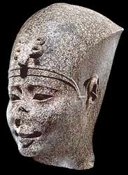 Nectanebo (from Boston Museum of Fine Arts): a granite head of a man with a fancy hat