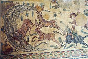 Roman mosaic of men surrounding deer with nets