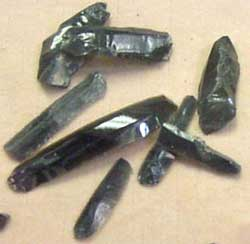 Obsidian tools: thin sticks of obsidian glass chipped into knives and arrowheads
