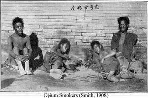 poor chinese people lying on the ground smoking opium
